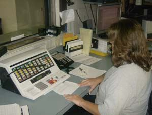 Woman working in the Communications Center.